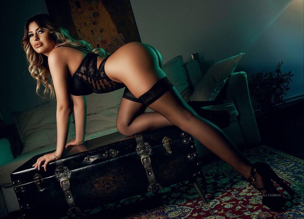 A Sensual Blond Woman in Black Lingerie